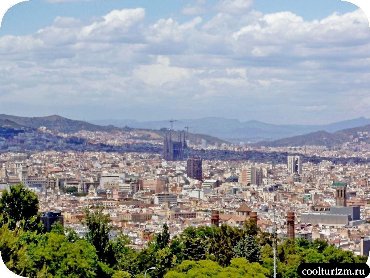 Гора Монжуик в Барселоне вид на Саграду Фамилию с горы Монжуик